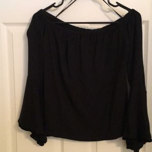 Black off the should top with bell sleeves